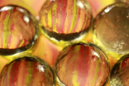 Glass marbles in oil and water