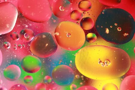 Colored bubbles of oil mixed with water