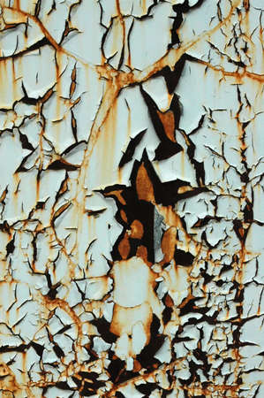 decaying: Paint peeling off a rusty wall Stock Photo
