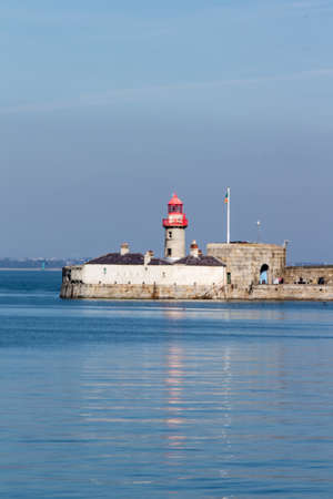 dun: Lighthouse of one of the largest harbours in Irleland, the lighthouse is located at the end of the East Pier Stock Photo