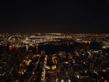 nightshot: Nightshot of NYC from the Empire State building observation deck with view on the river