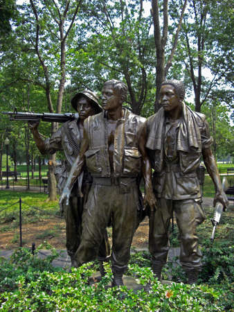 prisoner of war: Statue of the three soldiers at the Vietnam Veterans Memorial in Washington D.C. that are looking on the roll of honour