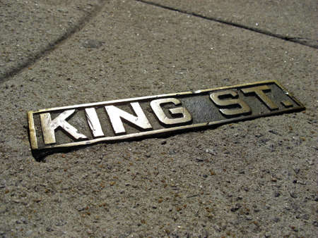 king street: Golden street sign on the walkway of the King Street  King St. in Charleston South Carolina USA in honor of King Charles II of England