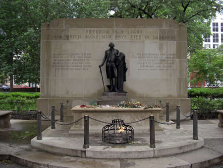 tomb unknown soldier: The memorial at Washington Square in Philadelphia Pennsylvania USA known as Tomb of the Unknown Revolutionary War Soldier or sometimes referred as Tomb of the Unknown Soldier of the American Revolution which is marked with flowers and lightning fire