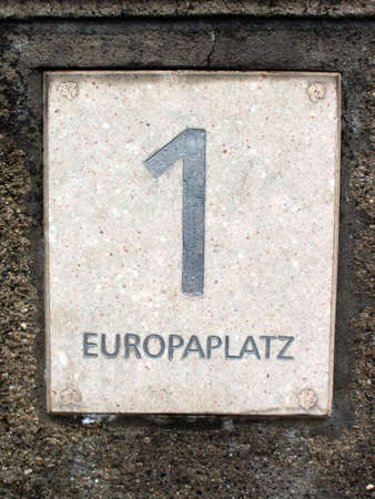 located: Label shows a large number one and below the street Europaplatz which is Place of Europe the address label is located in Munich Bavaria