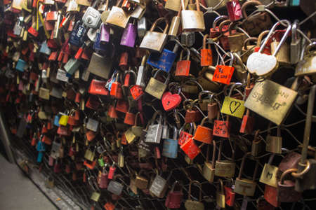 salzach: Locks as a symbol for everlasting love hanging on a bridge over the river Salzach in Salzburg Austria