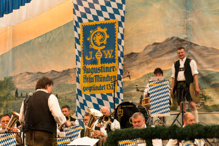 making music: Band making music for the people in the beer tent with traditional bavarian music with brass instruments