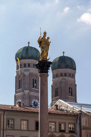vital: Marienplatz also called Marys Square is one of the most vital places in Munich with the Mariensule Marian column and the view on the Frauenkirche Cathedral of Our Dear Lady