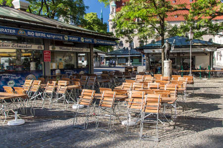 seating area: Outdoor seating area of a closed restaurant at the Viktualienmarkt