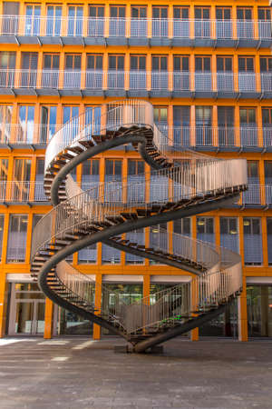 double helix: Rewriting stairs sculpture in form of a double helix with infinite stairs, the sculpture is 9 meter high and was designed by Olafur Eliasson in 2004, it is located in the courtyard of the KPMG office building