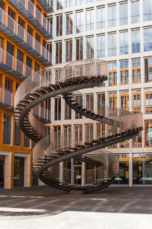 rewriting: Rewriting stairs sculpture in form of a double helix with infinite stairs, the sculpture is 9 meter high and was designed by Olafur Eliasson in 2004, it is located in the courtyard of the KPMG office building