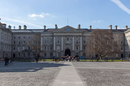 flagging: In the courtyard of the University of Dublin with students and tourists passing by