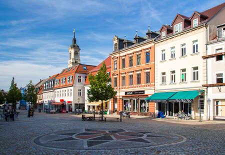 flagging: The marketplace of Werdau is built by using flagging and has a beautiful facade of the buildings