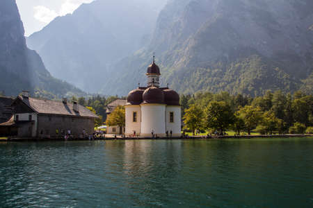 berchtesgaden: The Koenigssee near Berchtesgaden in Bavaria, with the Church of St. Bartholomew on a sunny day Stock Photo