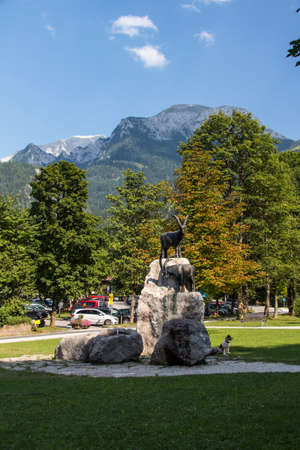 two animals: A statue with two animals on the rocks, the sculpture is located in Schoenau at the entrance to lake Koenigssee