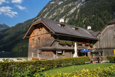 fishery: Buildings made of wood of the local fishery St. Bartholomae, the fishing hut is located at the Koenigssee