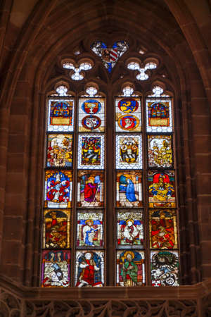 laurence: Windows of the St. Lorenz Church with beautiful and colorful themes Editorial