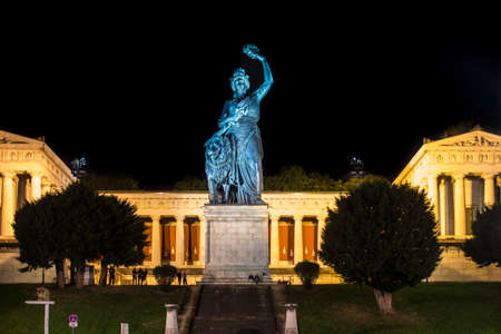nightshot: Nightshot of the Bavaria is a monumental, bronze sand-cast 19th-century statue with the hall of fame in the background, the statue is located at Theresenwiese in Munich, where the famous Oktoberfest takes place Editorial
