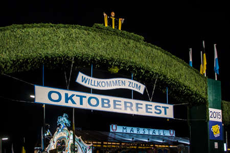 nightshot: Nightshot of the main entrance gate to the Oktoberfest at Theresienwiese in Munich Editorial