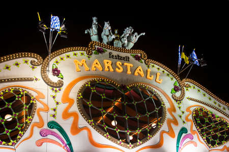 wiesn: Nightshot of the Marstall tent on the Theresienwiese in Munich during Oktoberfest Editorial