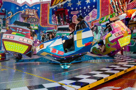 wiesn: Carousel Break Dancer in motion on Theresienwiese at Oktoberfest Editorial