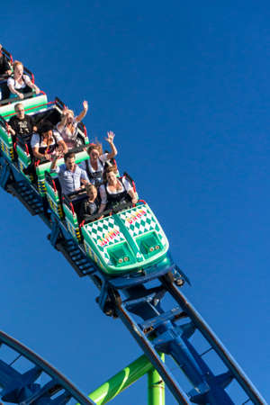 The Alpinabahn rollercoaster at Oktoberfest is a famous fun ride and attracts many people