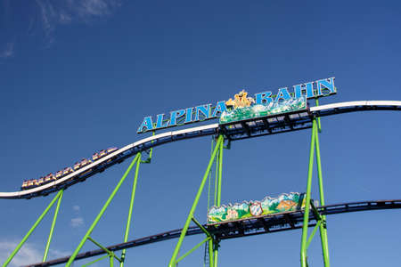 wiesn: The Alpinabahn rollercoaster at Oktoberfest is a famous fun ride and attracts many people