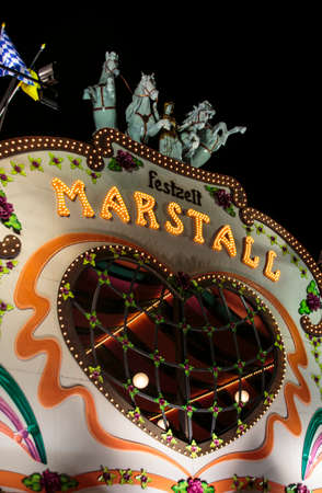 nightshot: Nightshot of the Marstall tent on the Theresienwiese in Munich during Oktoberfest Editorial