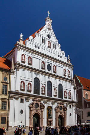 jesuit: St. Michael is a Jesuit church in the inner city of Munich and one of the largest Renaissance churches in Europe, unidentified people are walking along