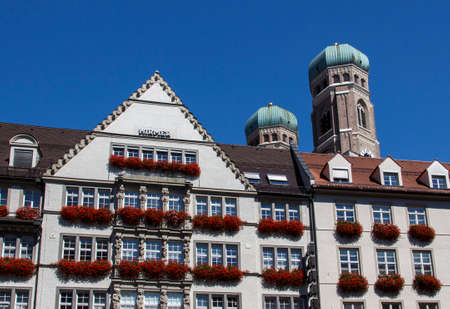 The Hirmer house with its beautiful decoration is the largest mens fashion house in the world, in the background are the towers of the Frauenkirche (Cathedral of Our Dear Lady Editorial