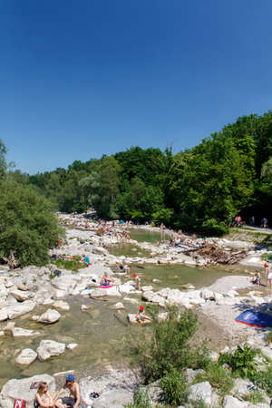 sunbath: The Isar river in Munich with many unidentified people on a sunny day taking a sunbath