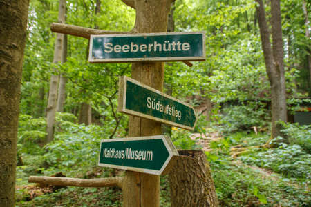Guidepost in the forest near Roemhild showing the way to the Seeberhuette, to the museum and to the mountain via the southern route