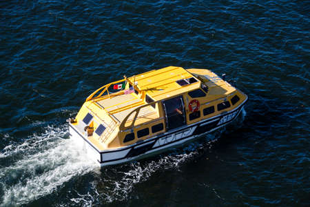 tenders: Ships tender boat of AIDA Dive cruise ship in the bay of Bar Harbor
