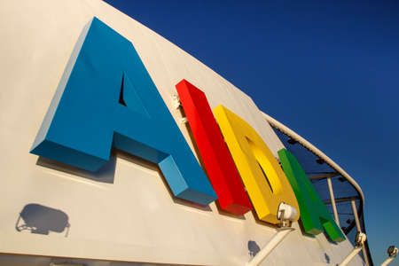 characteristic: The cruise ship AIDA Diva with its characteristic colored logo in the bay of Bar Harbor (Maine, USA)