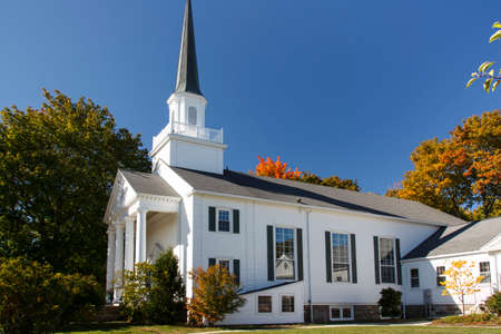 The Bar Harbor Congregational Church is located on the Village Green in the center of the city Stock Photo