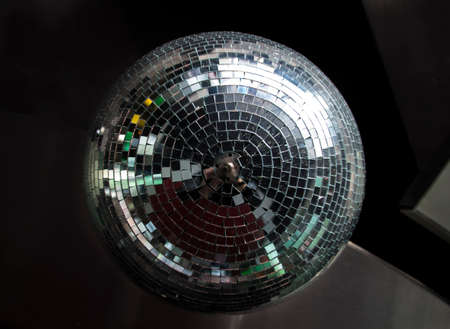 mirror ball: Silver mirror ball hanging down a bar in a disco Stock Photo