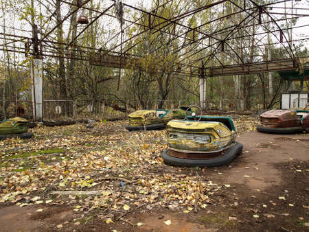 Former amusement park with bumper cars in Pripyat, the ghost town in the Chernobyl Exclusion Zone which was established after the nuclear disaster