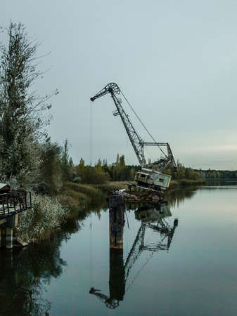 exclusion: Port crane in the harbor near Pripyat, the ghost town in the Chernobyl Exclusion Zone which was established after the nuclear disaster