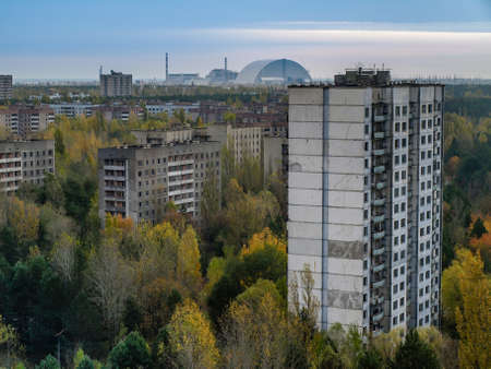 exclusion: The ghost town Pripyat with the nuclear power plant in the Chernobyl Exclusion Zone which was established after the nuclear disaster in 1986