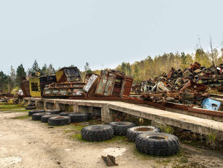disposed: Scrap yard in the Chernobyl Exclusion Zone with old military vehicles and other scrap that was disposed after the nuclear disaster