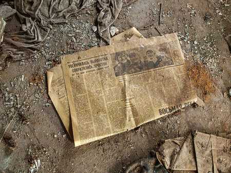 Old newspaper in the ghost town Pripyat in the Chernobyl Exclusion Zone which was established after the nuclear disaster in 1986