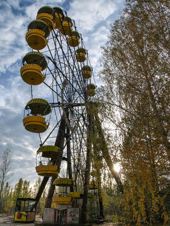 Former amusement park with a ferris wheel in Pripyat, the ghost town in the Chernobyl Exclusion Zone which was established after the nuclear disaster