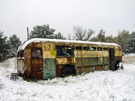 disposed: Rusty bus in the Chernobyl Exclusion Zone that was disposed after the nuclear disaster Stock Photo