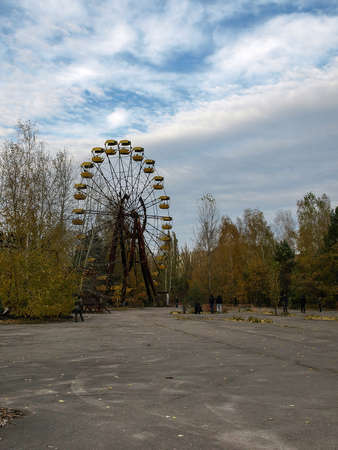 exclusion: Former amusement park with a ferris wheel in Pripyat, the ghost town in the Chernobyl Exclusion Zone which was established after the nuclear disaster
