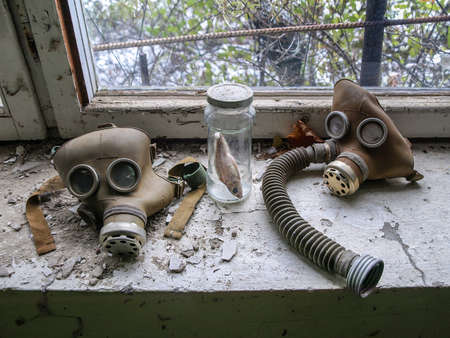 exclusion: Gas masks lying on a window board in the ghost town Pripyat in the Chernobyl Exclusion Zone which was established after the nuclear disaster in 1986