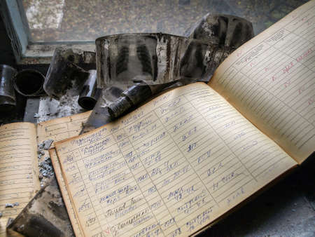 exclusion: Radiograms (chest x-rays) and a book lying in the ghost town Pripyat in the Chernobyl Exclusion Zone which was established after the nuclear disaster in 1986 Stock Photo