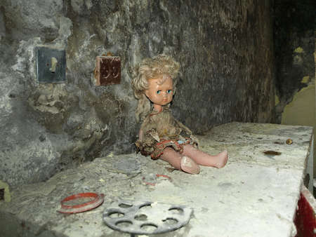 Doll on a cupboard in the ghost town Pripyat in the Chernobyl Exclusion Zone which was established after the nuclear disaster in 1986