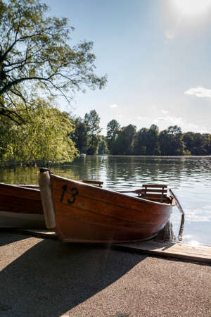 The Englischer Garten (English Garden) is a large public park in the centre of Munich and boats are available for rental Stock Photo