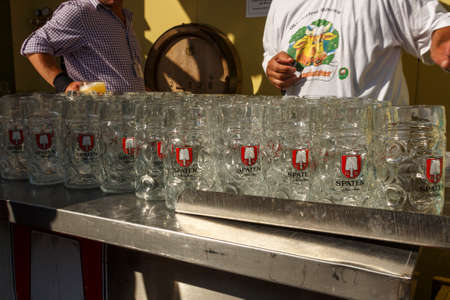 steins: Munich, Germany - September 24, 2016: Behind the scenes of the Oktoberfest in the beer garden of the Ochsenbraterei with beer steins being cleaned and prepared
