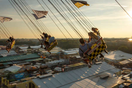 Munich, Germany - September 24, 2016: Carousel in motion with people flying through the air on Theresienwiese above the Oktoberfest fairground